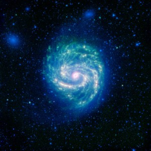 The galaxy Messier 100, or M100, shows its swirling spiral in this infrared image from NASA's Spitzer Space Telescope. The arcing spiral arms of dust and gas that harbor starforming regions glow vividly when seen in the infrared.